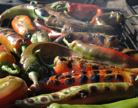 Peppers roasting over charcoal. These will definitely taste better than gas roasted peppers.