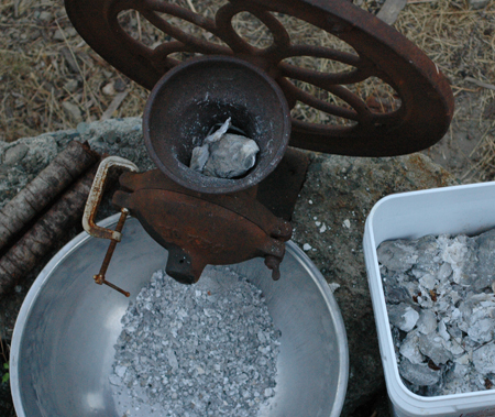 The Enterprise corn, bone and shell grinder in use for grinding oyster shells. Works great for charcoal.