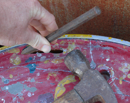 chiseling out the top of a drum is easy with a sharp cold chisel and a hammer.