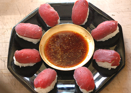 Venison sushi, my new favorite way to eat venison. The meat is previously frozen, which should take care of parasites. I'll be cleaning my deer more carefully next year to maximize sashimi potential. I'm making some for lunch in a few minutes, yum.